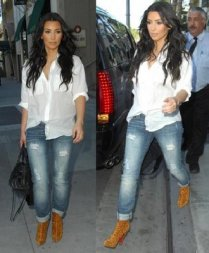 Kim K West has mastered the art of the sexy rockstar persona with her flowy tops, fitted jeans, and a nice booty or heel.