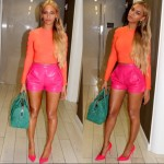 I think Queen Bey is feelin' herself in these high-waisted leather shorts, orange crop and long tresses. Can you blame her? Love these colors!