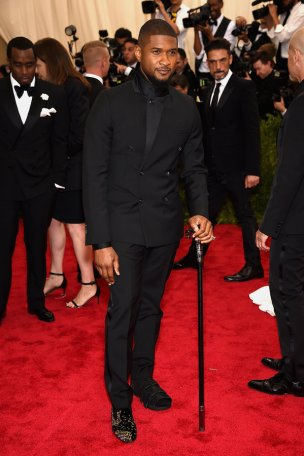 Come on Usher!!! I love his swag with this tux, rocking a cane after his recent foot surgery.