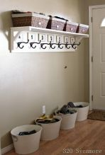 A foyer with coat racks and baskets for knick-knacks is warm and inviting.