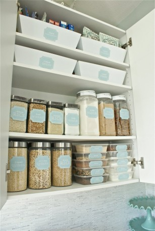 Modernize your kitchen by removing foods from their packaging and placing into similar containers.